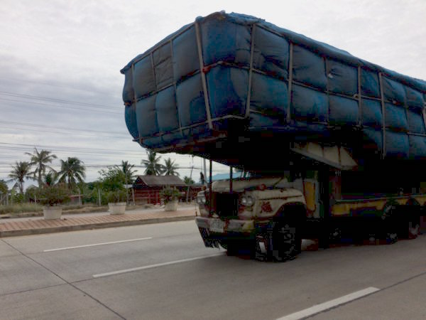 Extremely overloaded trucks like this are a common sight.