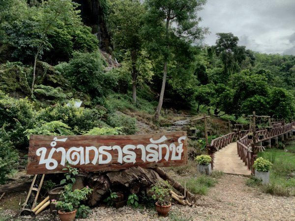 I can't read Thai, and so I assumed the sign says this way to the waterfall.