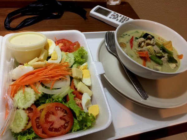 "The skies opened and poured from late afternoon till evening. I was warm and dry in my hotel room, but was hungry. Since I didn't want to ride in the rain, I ordered some food from the hotel. THB120 for the green curry and the ""King salad""."