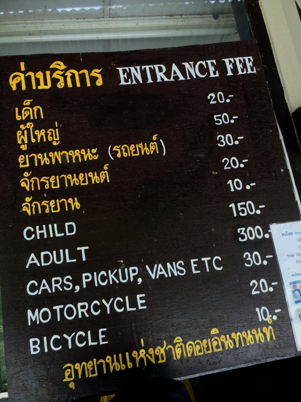 "Entrance fees for the Doi Inthanon National Park. I'm pretty sure it says ""Thai prices in gold, tourist prices in white."" I paid 320 baht - 300 baht for me, and 20 baht for the Pulsar."