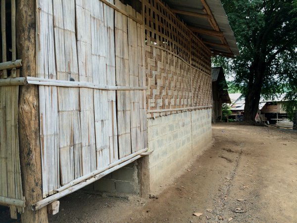 The walls of most buildings here in the Karen Village are made of woven bamboo.