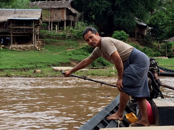 The boatman taking me to the Karen Village.