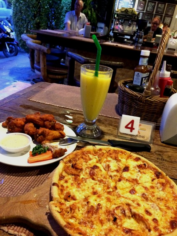 Pizza, some buffalo wings, and a glass of mango smoothie to end the day.