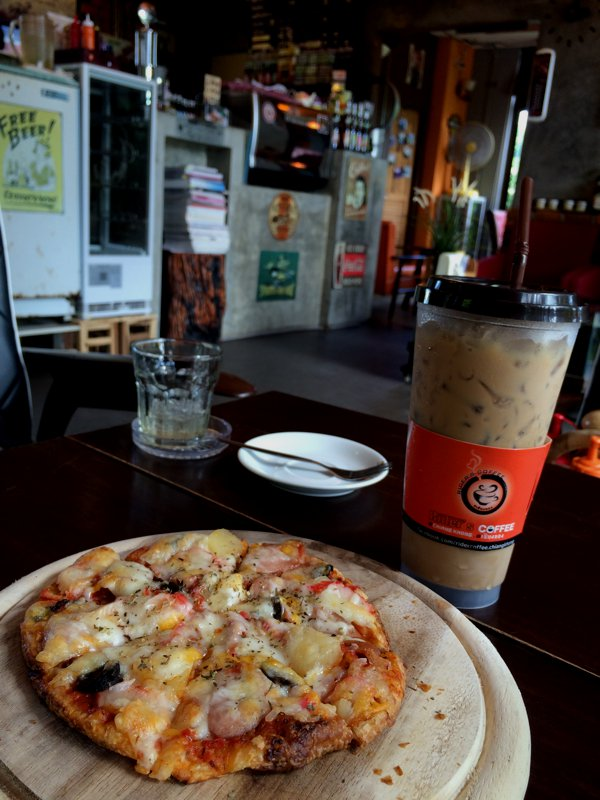 Lunch. Pizza and iced-coffee at Rider's Cafe. They were playing english music in the cafe!