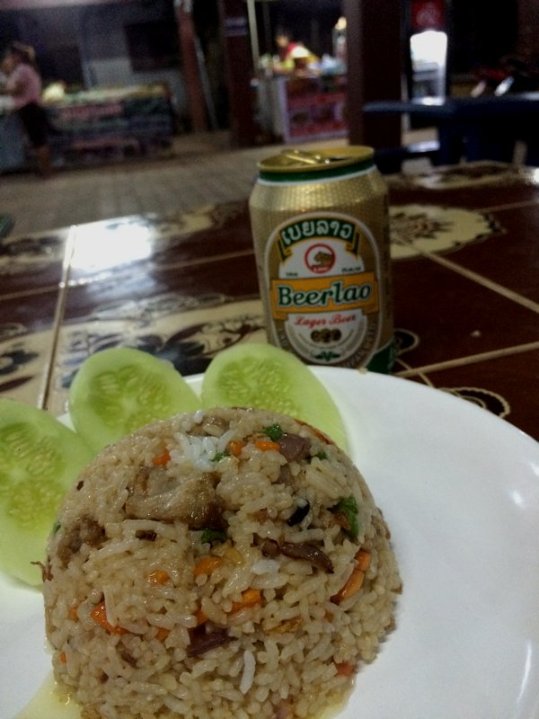 My first Laotian dinner. Fried rice with pork and a beer Laos. 25,000kips for the meal.