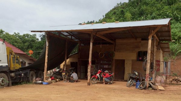 Passed by this motorcycle repair shop. Very, very basic bike repair shops are commonplace in Laos.