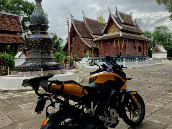 The nice lady at the entrance allowed me to park my bike within the compound of Wat Xieng Thong. I think this is the main temple in Luang Prabang. Entrance fee - 20,000K.