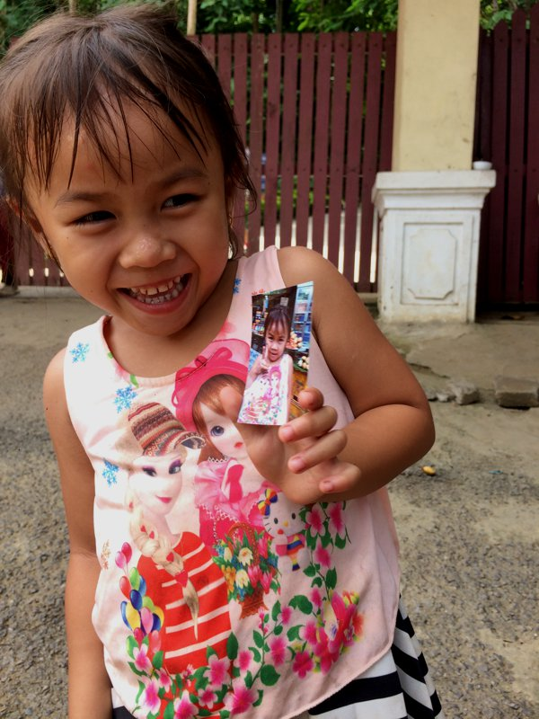 Happy was very happy after receiving her very own pic.