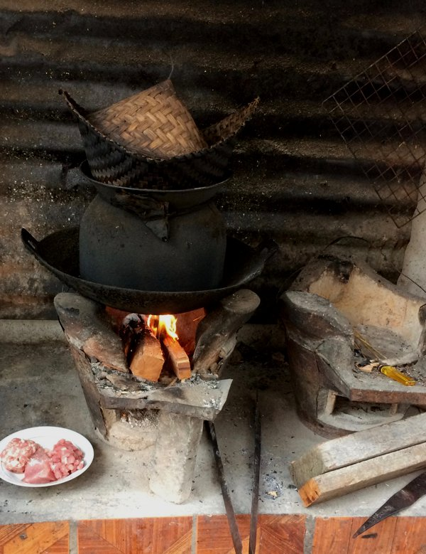 I wandered around the remoter part of Luang Prabang, and spotted someone cooking over a firewood stove.