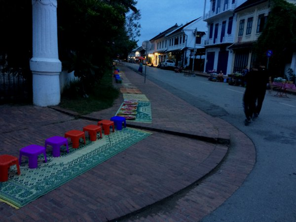 Local vendors have set up these stools and mats mainly for tourists to participate in the alms giving ceremony.