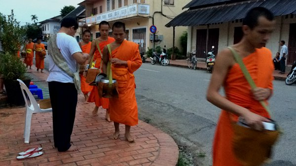It was a very sacred and quiet event as the monks walked silently through the streets to collect their alms. Each monk is given a pinch of sticky rice - roughly about the size of my thumb.