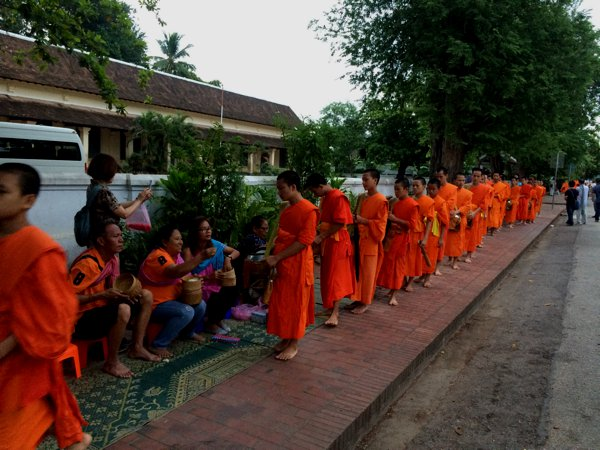 Monks lining the street to collect alms.