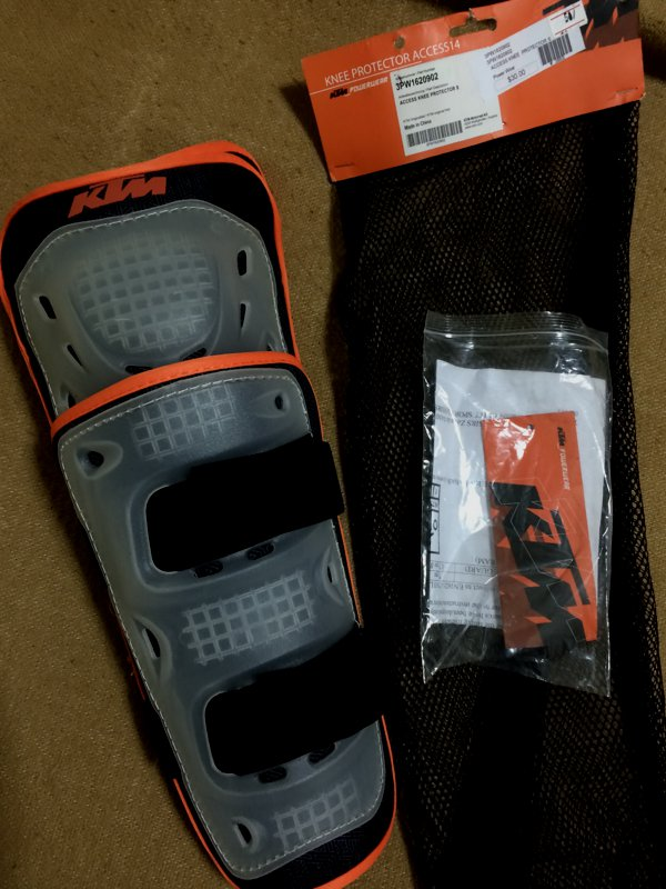 The KTM knee protectors were going for 50% off. USD15 a pair. I got a set.