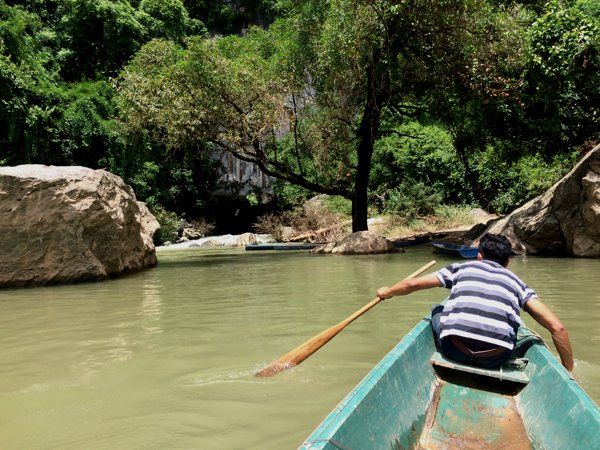 To get through Konglor Cave, first, you need to hop onto a row boat and get to the far bank.