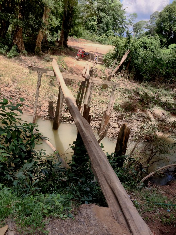 ...except this little bridge here. No vehicles passable. Even human passage is questionable. Used only by the locals - I suppose no tourists too.