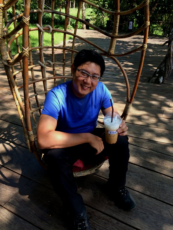 Me with a cup of iced-cuppacino in hand, and on a swing-chair overlooking the Mekong river. Yeah, I spent quite a while in idle daze here.