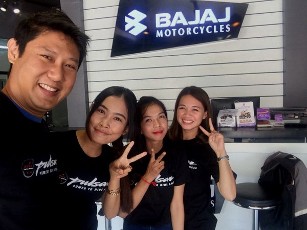 The pretty sales ladies at the Bajaj Phom Penh dealership.