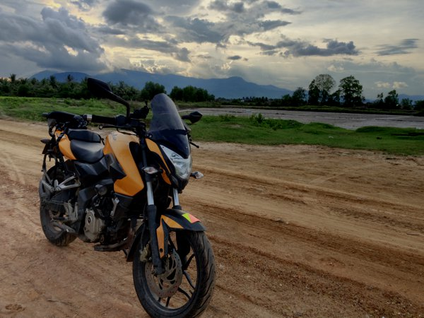 My Pulsar 200NS against the salt fields of Kampot.