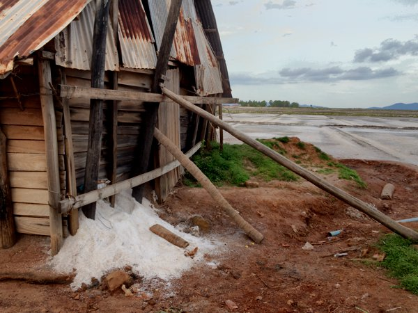 A salt storage facility overflowing with salt.