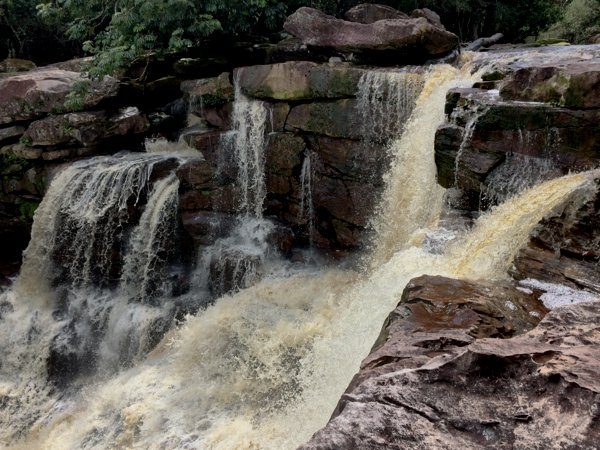 Popokvil waterfall in Bokor Mountain. Notice the water's brown tint?