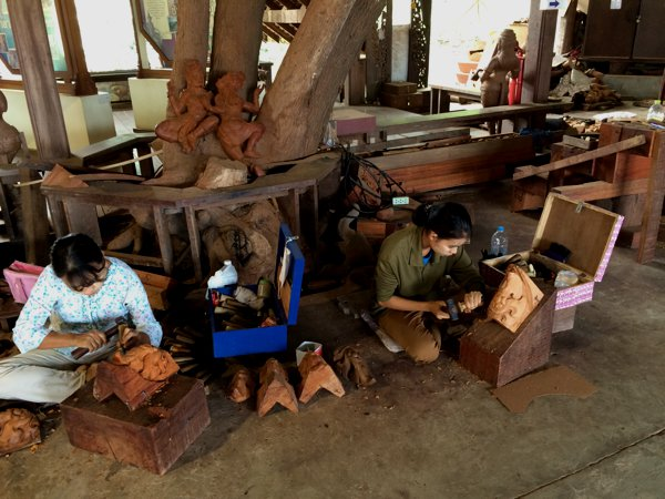 Woodworkers from Thailand, Myanmar and Laos work at the various wood carvings to be later installed inside or onto the Sanctuary of Truth.