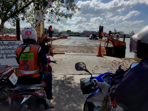 Motorcycles cannot use the bridges. Motorcycles are banished to the ferries. 10Baht for the river crossing.
