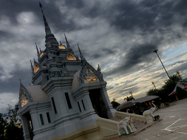 The Surat Thani City Pillar Shrine against the setting sun.